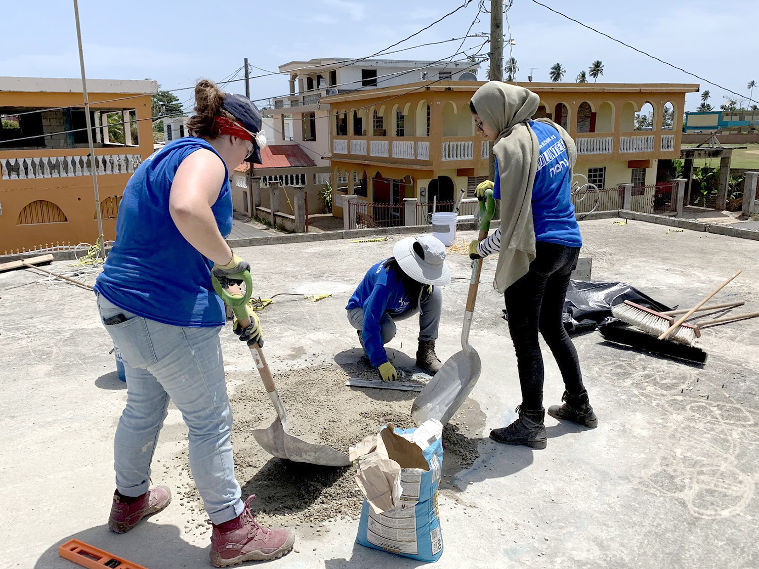 Students help patch a roof in Puerto Rico