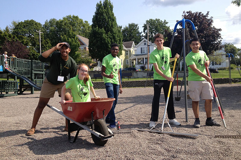 Students volunteering in playground