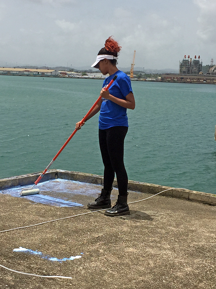Tatyanna Hiciano primes a roof in Puerto Rico