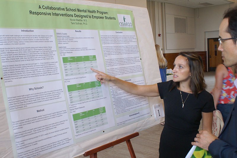 Counseling and psychological services graduate student Nicole Maether explains her research
