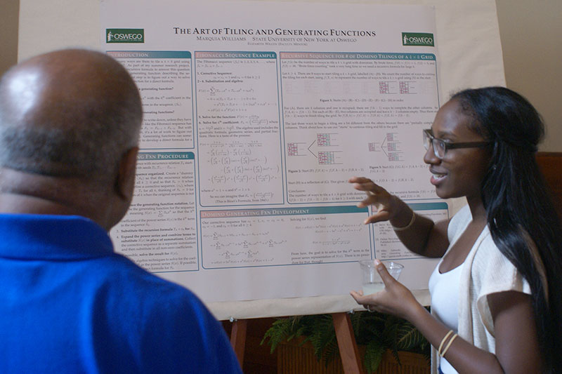 Mathematics major Marquia Williams presents her poster