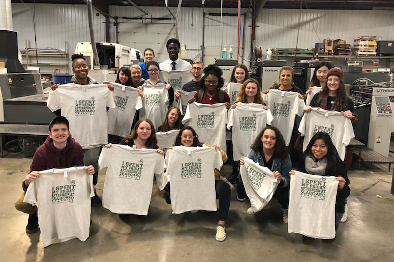 Students who attended Seaboard Graphics visit show off new T-shirts