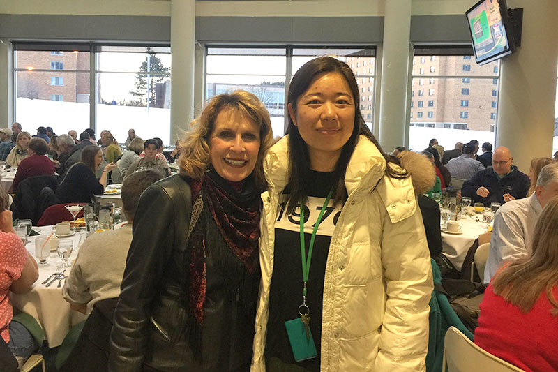 College President Deborah F. Stanley greets Zhiling Yang