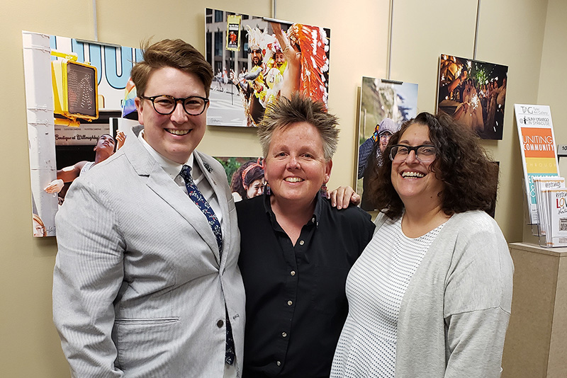 Art faculty member Amy Bartell (center), coordinator of community art exhibitions, greets photographer Katie Simmons-Barth (left) and partner Lisa Simmons-Barth at the opening for Simmons-Barth's exhibition, Resistance, Love and Show Tunes