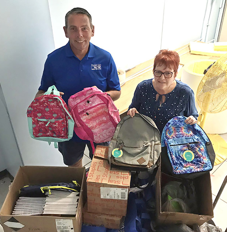 The college collected many school supplies for the annual Stuff A Bus effort for kids who need them