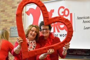 Staff posing with heart