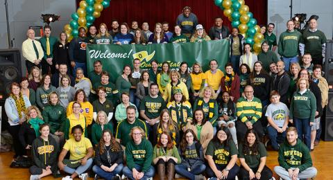 Campus community members in green and gold