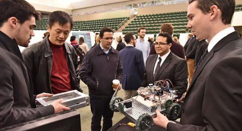 Students demonstrating a robotic car