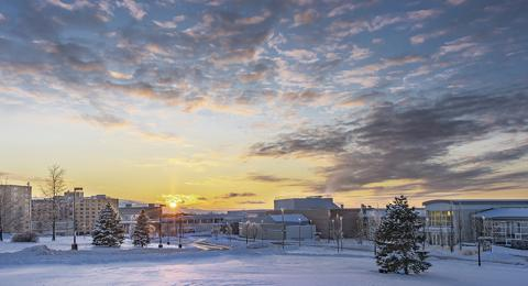 Sunset paints colors on snow-covered SUNY Oswego landscape