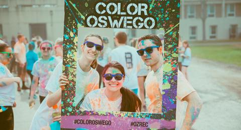 Students wearing colorful dye after Color Oswego Run