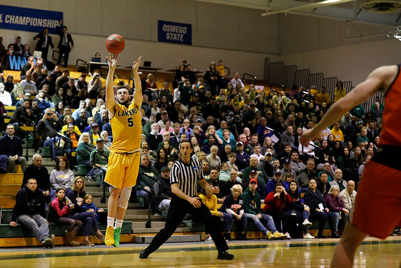 Joe Sullivan launches a three-point shot as the nationally ranked men's basketball team wins