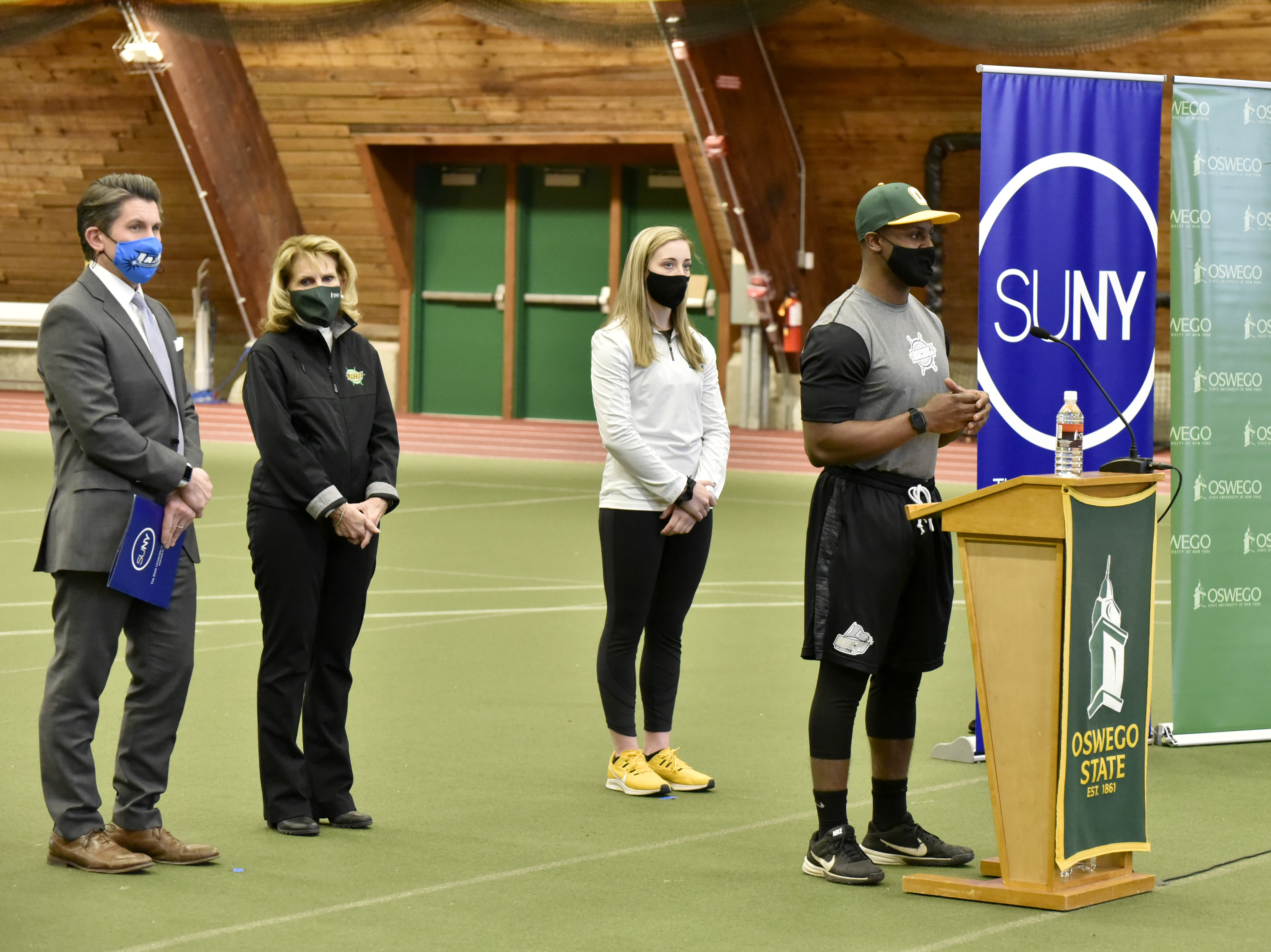 Myles Felton, an outfielder for the Laker baseball team, speaks at a Feb. 23 news conference where SUNY Chancellor Jim Malatras (left) announced that the SUNY Athletic Conference will resume play March 20 for spring sports