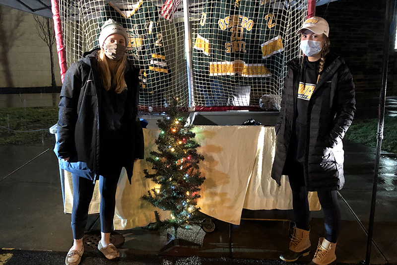 Laker women's hockey players Aislinn McAleer and Kamryn Barnes welcome community donations