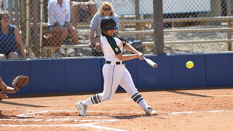Rebecca Vilchez hitting a softball