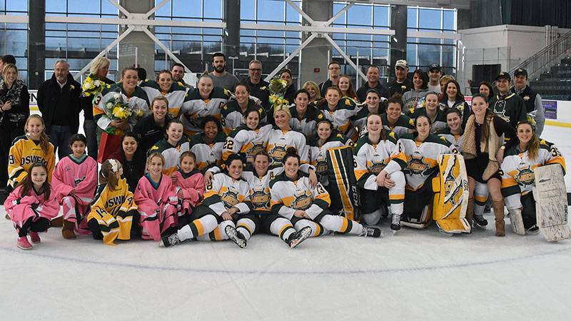 Laker women's hockey team, families, coaches, fans celebrate