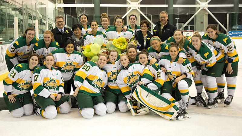 Women's hockey players celebrate Senior Day