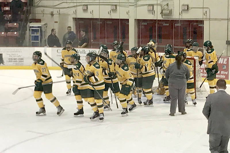 Laker women's hockey team heads for the postgame handshake line