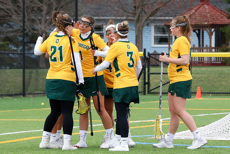 Women's lacrosse players celebrate