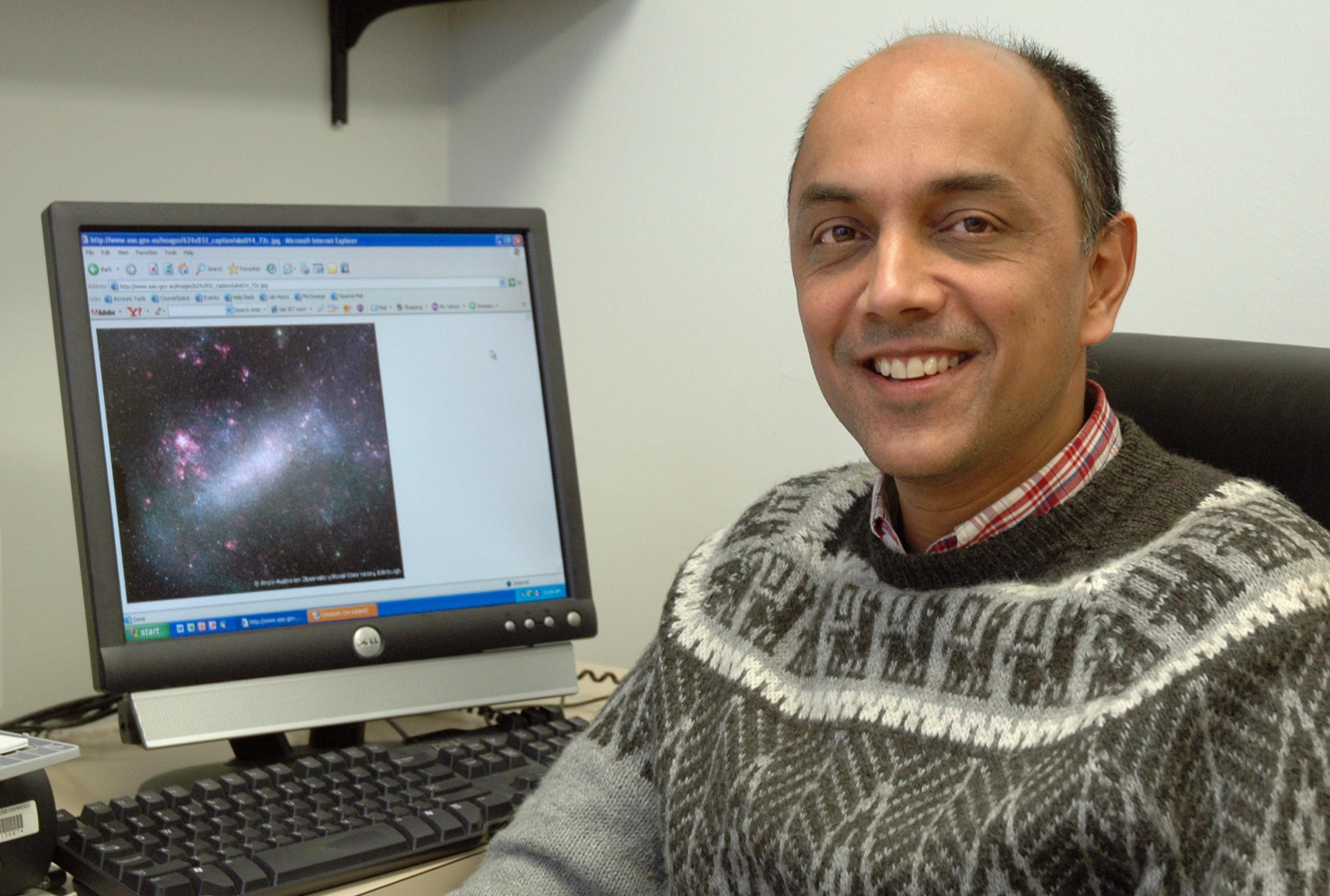 Professor Shashi Kanbur at computer