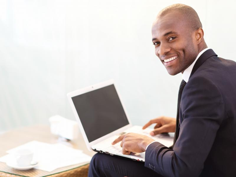 online student male on computer