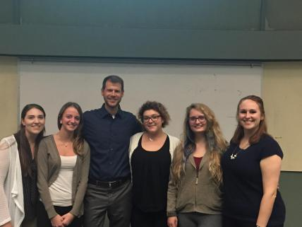 Social psychologist, Jon Maner, poses for photo with students