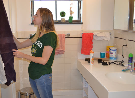 student gets her towel in her spacious village townhouse bathroom