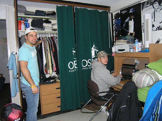 2 male students in an Onondaga Hall room.