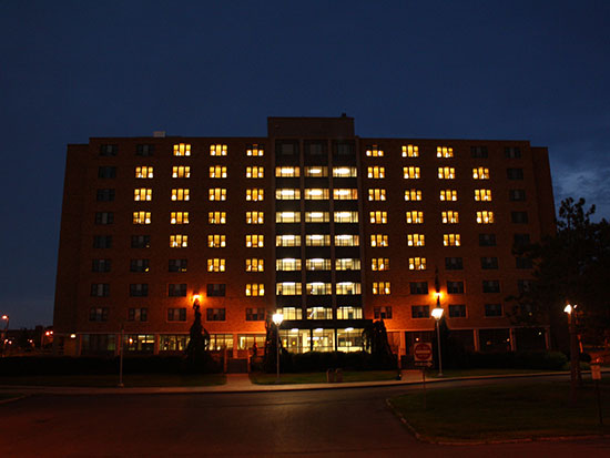 Night view of Hart Hall building with the lights of the rooms in the shape of a heart.