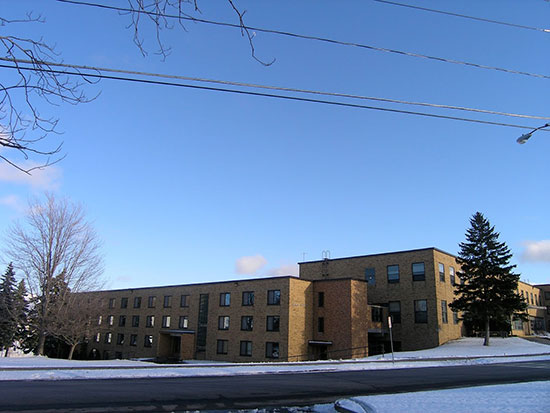 Winter scene of Lonis Hall, the northern part of Mackin Complex.