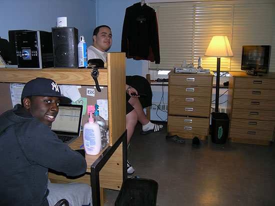 Two male roommates hanging out in their bedroom in Scales Hall.
