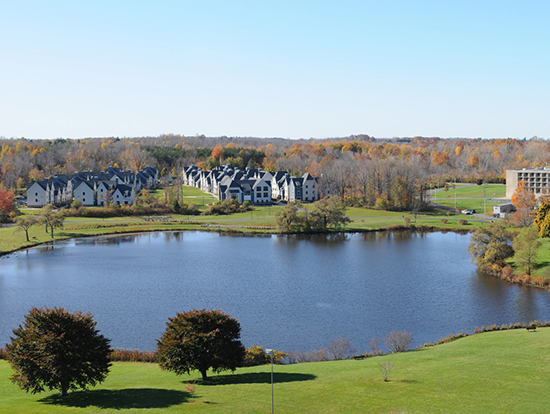 Fall scene of The Village nestled on Glimmerglass Lagoon.