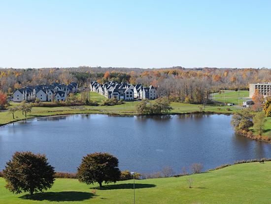 Fall scene of The Village nestled on Glimmerglass Lagoon.