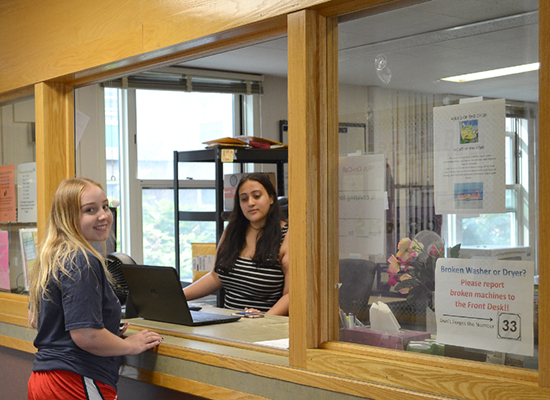 Student in Oneida Hall visits the Front Desk.