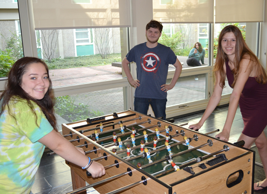 Oneida Hall lounge is a great place to meet up with friends for a game of foosball.