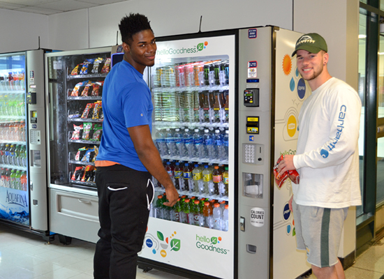 Seneca Hall residents grab a snack from the vending machine in the lobby.