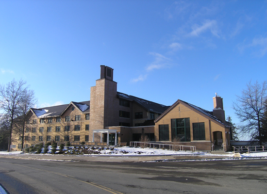 Riggs Hall in winter, blue skies.