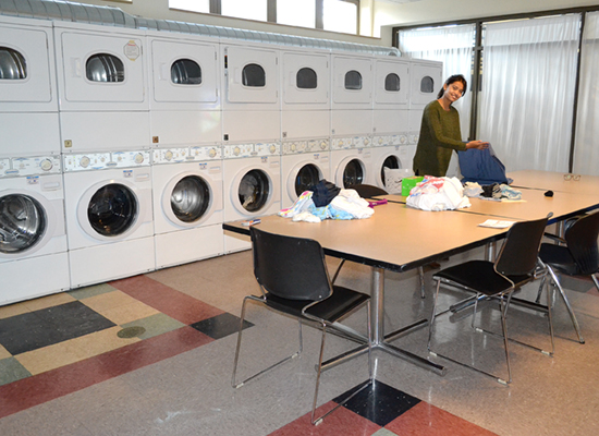 A Hart Hall resident has this spacious laundry room all to herself while folding a big pile of clothes.