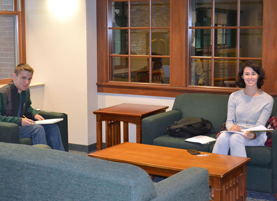 Students do homework in a public seating area just outside of the Johnson Hall main lounge.
