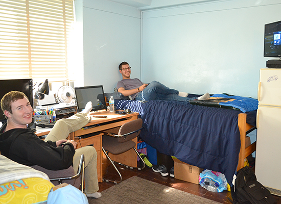 Moreland Hall (part of the Mackin Complex) residents hang out in their double room.