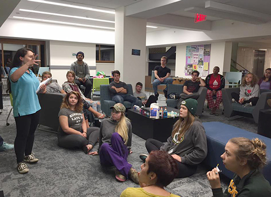 Students attend a presentation in the Scales Hall basement lounge.