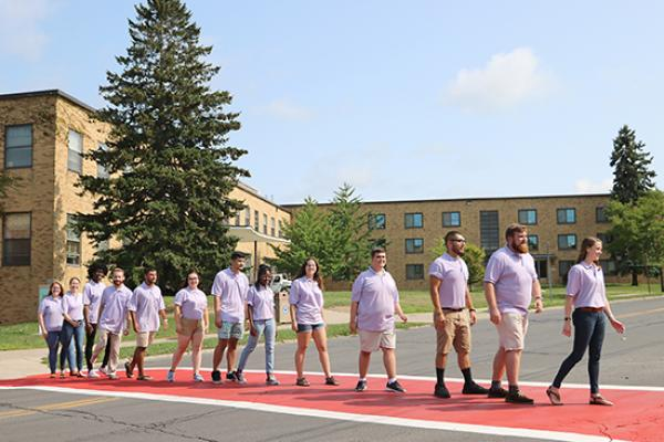 Mackin Complex (Moreland and Lonis Halls) and Sheldon Hall Resident Student Staff group photo. Re-enact the album cover of Abbey Road for fun.