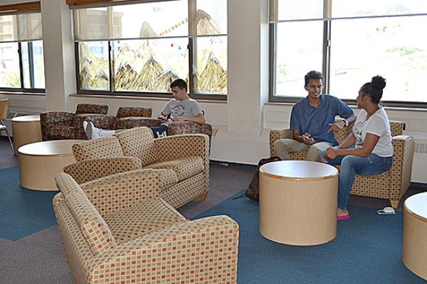 Hart Hall residents relax in the second floor lounge.