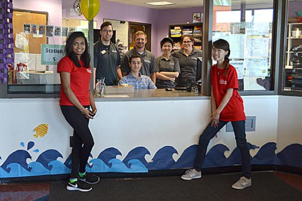 Hart Hall front desk helpers and Red Carpet Welcoming Crew at the front desk.