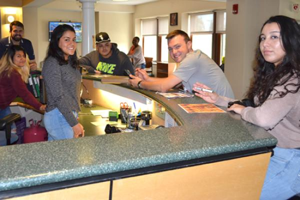 Students welcome you to Riggs Hall front desk.