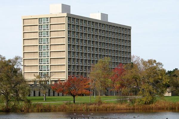 Seneca Hall on a beautiful fall day; with water fowl on Glimmerglass Lagoon.