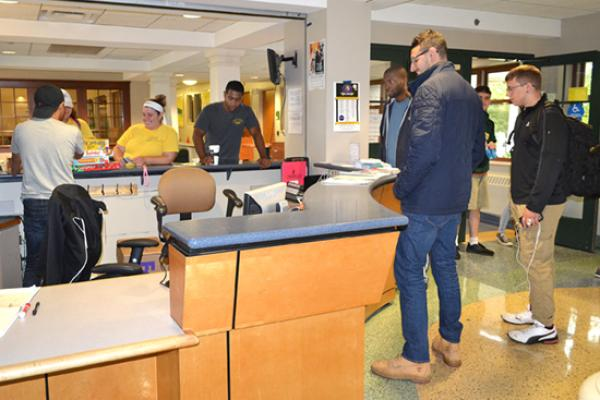 Johnson Hall front desk is a busy place for staff and students.