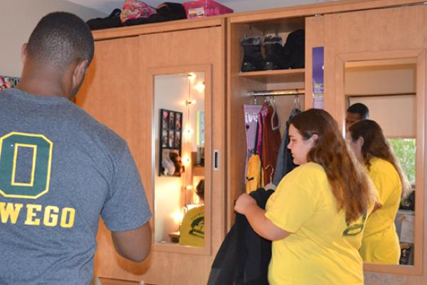 Residents of Johnson Hall are each assigned a large armoire with a mirror.