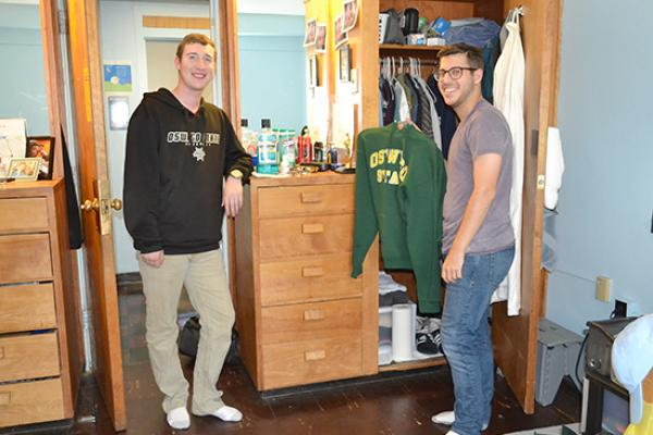 Moreland Hall (part of the Mackin Complex) residents in front of their closet/dresser unit.