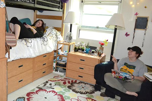cayuga Hall room, female students hanging out.