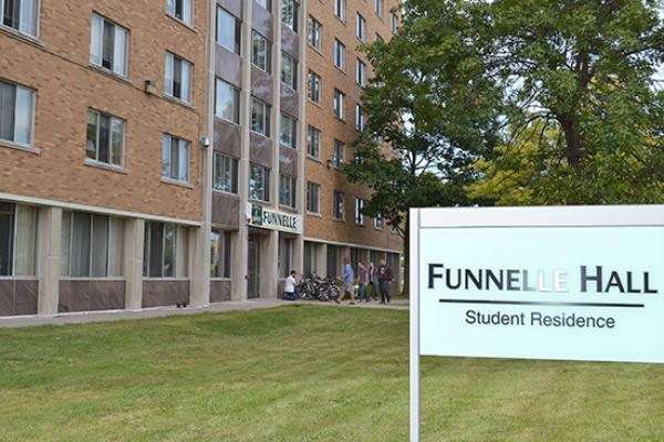 Funnelle Hall entrance and sign.